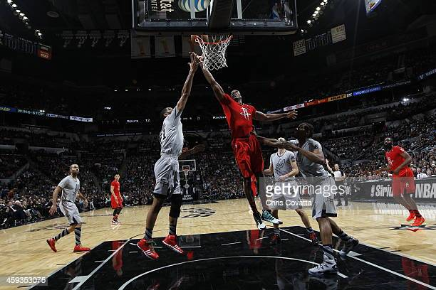 Dwight Howard of the Houston Rockets attempts a shot during a game against the San Antonio Spurs on December 25 2013 at the ATT Center in San Antonio...