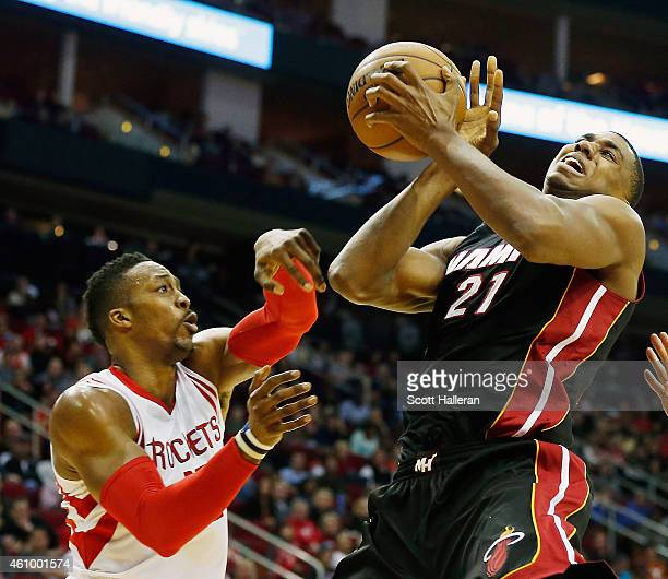 Dwight Howard of the Houston Rockets battles for a loose basketball with Hassan Whiteside of the Miami Heat during their game at the Toyota Center on...