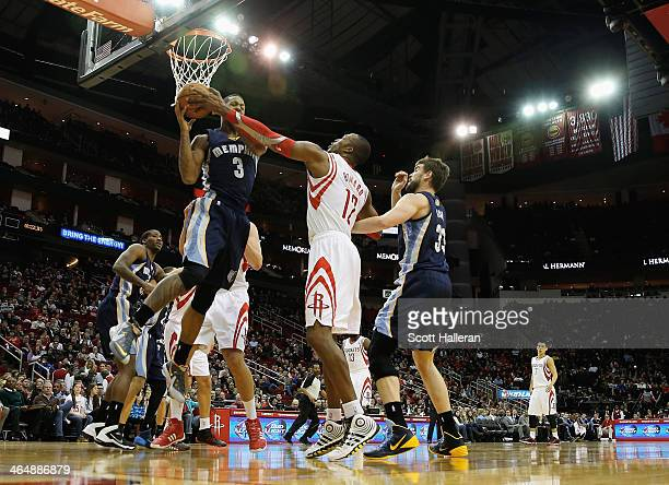 Dwight Howard of the Houston Rockets battles for a rebound with James Johnson of the Memphis Grizzlies during the game at the Toyota Center on...