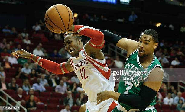 Dwight Howard of the Houston Rockets battles for the ball with Jared Sullinger of the Boston Celtics at the Toyota Center on November 19 2013 in...