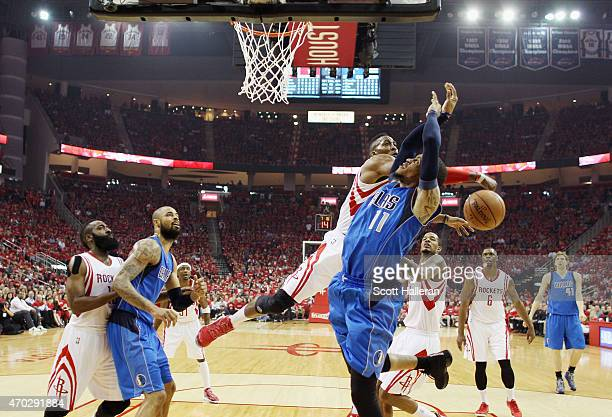 Dwight Howard of the Houston Rockets blocks a shot by Monta Ellis of the Dallas Mavericks during Game One in the Western Conference Quarterfinals of...