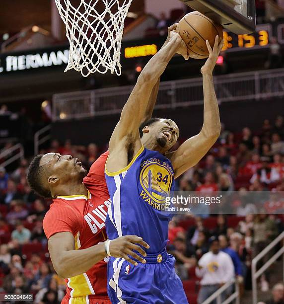 Dwight Howard of the Houston Rockets blocks the shot attempt by Shaun Livingston of the Golden State Warriors at Toyota Center on December 31 2015 in...