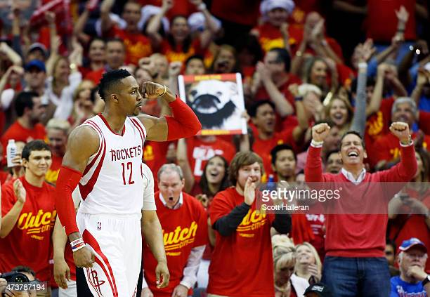 Dwight Howard of the Houston Rockets celebrates in the fourth quarter against the Los Angeles Clippers during Game Seven of the Western Conference...