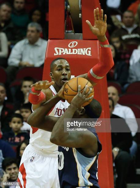 Dwight Howard of the Houston Rockets defends against Zach Randolph of the Memphis Grizzlies during the game at the Toyota Center on January 24 2014...