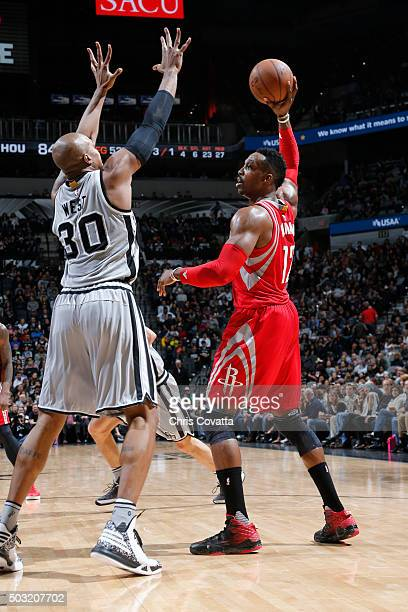 Dwight Howard of the Houston Rockets defends the ball against David West of the San Antonio Spurs during the game on January 2 2016 at ATT Center in...