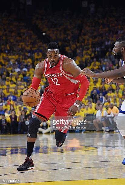 Dwight Howard of the Houston Rockets drives on Festus Ezeli of the Golden State Warriors in the first quarter in Game One of the Western Conference...