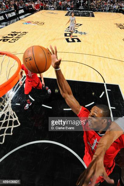 Dwight Howard of the Houston Rockets drives to the basket against the San Antonio Spurs during the game at the ATT Center on December 25 2013 in San...
