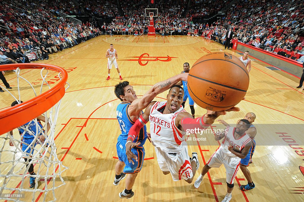 Dwight Howard #12 of the Houston Rockets drives to the basket against the Oklahoma City Thunder on January 16, 2014 at the Toyota Center in Houston, Texas.