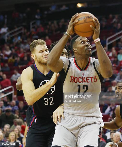Dwight Howard of the Houston Rockets drives with the basketball in front of Blake Griffin of the Los Angeles Clippers during their game at Toyota...