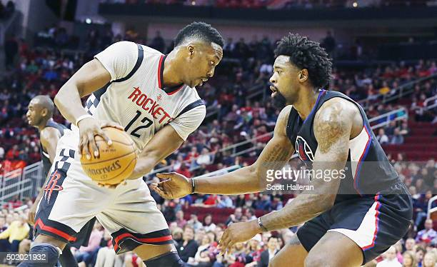 Dwight Howard of the Houston Rockets drives with the basketball in front of DeAndre Jordan of the Los Angeles Clippers during their game at Toyota...