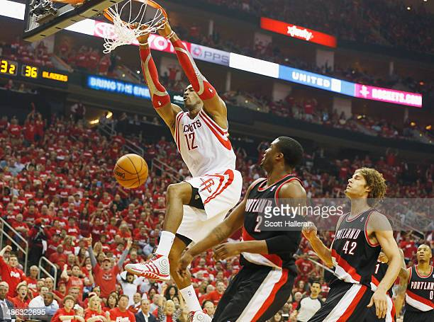 Dwight Howard of the Houston Rockets dunks over Wesley Matthews and Robin Lopez of the Portland Trail Blazers during the first half in Game Two of...