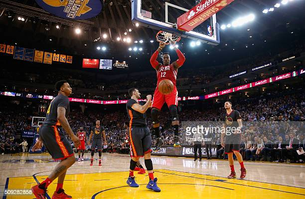 Dwight Howard of the Houston Rockets dunks the ball against the Golden State Warriors at ORACLE Arena on February 9 2016 in Oakland California NOTE...