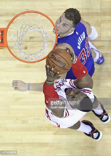 Dwight Howard of the Houston Rockets dunks the ball over Blake Griffin of the Los Angeles Clippers during Game Two in the Western Conference...
