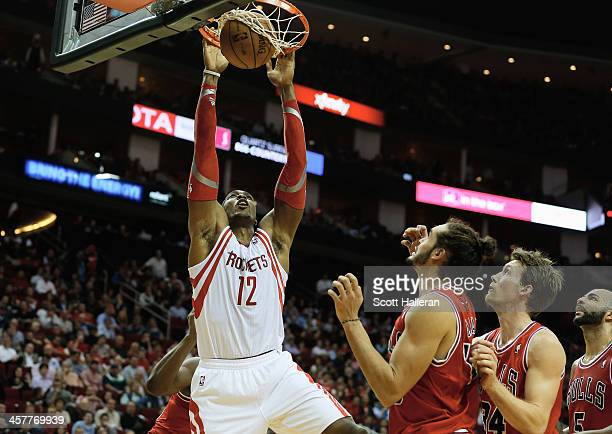 Dwight Howard of the Houston Rockets dunks the ball over Joakim Noah of the Chicago Bulls during the game at Toyota Center on December 18, 2013 in...