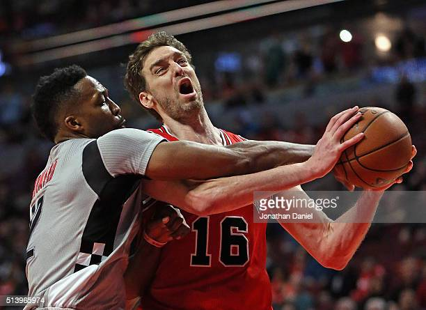 Dwight Howard of the Houston Rockets fouls Pau Gasol of the Chicago Bulls at the United Center on March 5 2016 in Chicago Illinois The Bulls defeated...