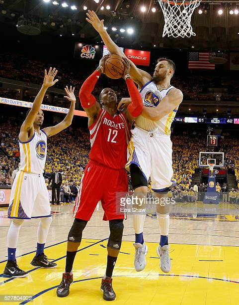 Dwight Howard of the Houston Rockets goes up for a shot against Andrew Bogut of the Golden State Warriors in Game Five of the Western Conference...