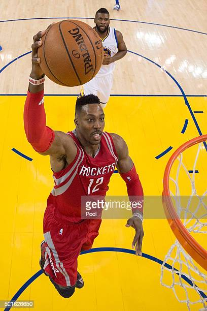 Dwight Howard of the Houston Rockets goes up for a slam dunk against the Golden State Warriors in the second half in Game One of the Western...