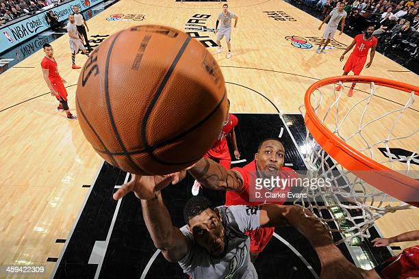 Dwight Howard of the Houston Rockets grabs a rebound against the San Antonio Spurs during the game at the ATT Center on December 25 2013 in San...