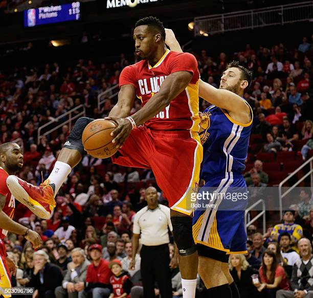 Dwight Howard of the Houston Rockets grabs a rebound from Andrew Bogut of the Golden State Warriors at Toyota Center on December 31 2015 in Houston...