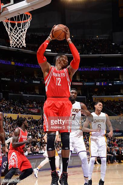 Dwight Howard of the Houston Rockets grabs the rebound against the Los Angeles Lakers on January 17 2016 at STAPLES Center in Los Angeles California...