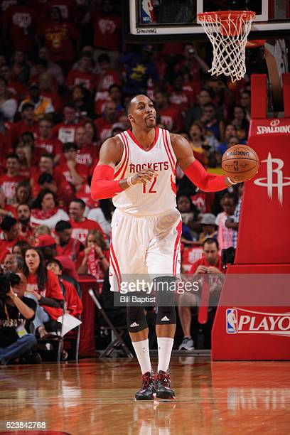 Dwight Howard of the Houston Rockets handles the ball against the Golden State Warriors in Game Four of the Western Conference Quarterfinals during...