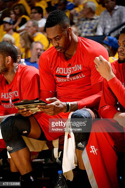 Dwight Howard of the Houston Rockets looks at his tablet during a game against the Golden State Warriors in Game Five of the Western Conference...