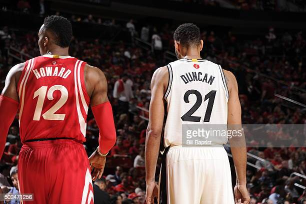 Dwight Howard of the Houston Rockets looks on against Tim Duncan of the San Antonio Spurs on December 25 2015 at Toyota Center in HoustonTexasNOTE TO...