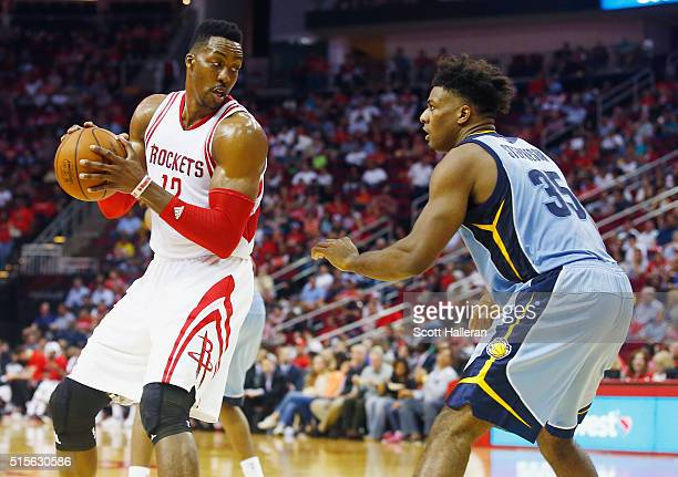 Dwight Howard of the Houston Rockets looks to drive with the basketball against Alex Stepheson of the Memphis Grizzlies during their game at the...