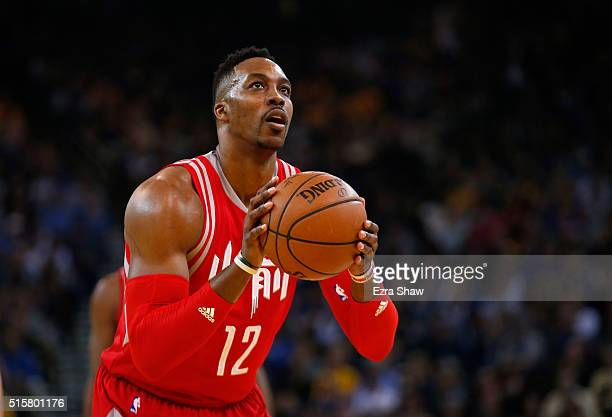 Dwight Howard of the Houston Rockets shoots a free throw against the Golden State Warriors at ORACLE Arena on February 9 2016 in Oakland California...