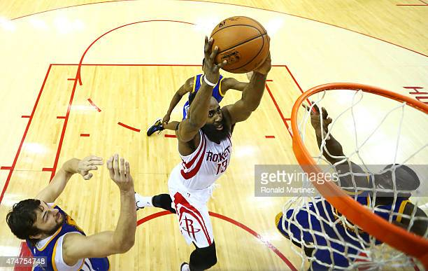 Dwight Howard of the Houston Rockets shoots against Andrew Bogut of the Golden State Warriors in the second half during Game Four of the Western...