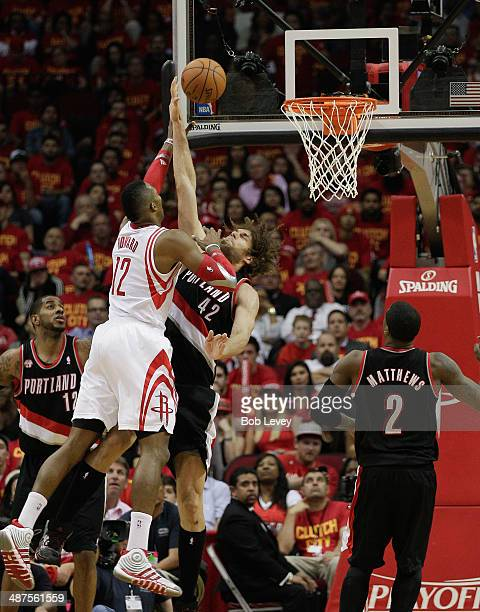 Dwight Howard of the Houston Rockets shoots over Robin Lopez of the Portland Trail Blazers as Wesley Matthews of the Portland Trail Blazers looks for...