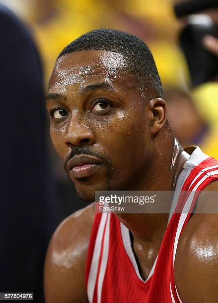 Dwight Howard of the Houston Rockets sits on the bench during their game against the Golden State Warriors in Game Five of the Western Conference...