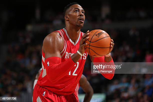 Dwight Howard of the Houston Rockets takes a free throw against the Denver Nuggets at Pepsi Center on November 13 2015 in Denver Colorado The Nuggets...