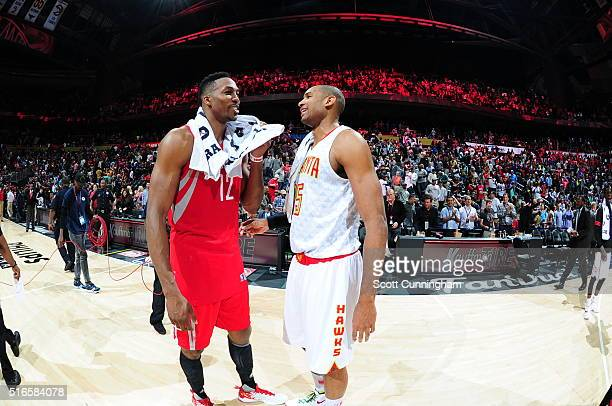 Dwight Howard of the Houston Rockets talks with Al Horford of the Atlanta Hawks after the game on March 19 2016 at Philips Center in Atlanta Georgia...
