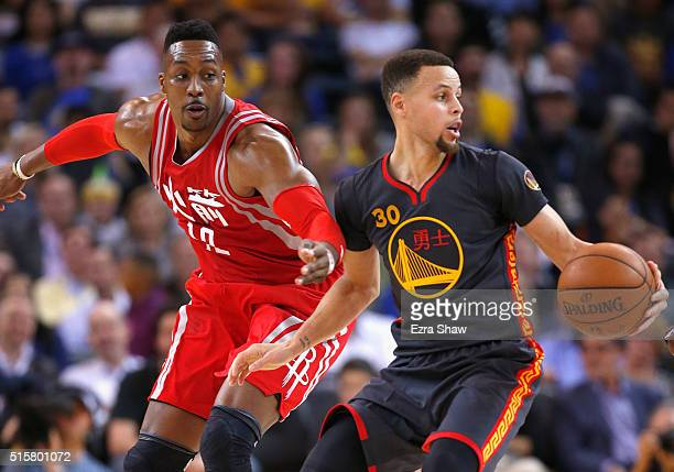 Dwight Howard of the Houston Rockets tries to steal the ball from Stephen Curry of the Golden State Warriors at ORACLE Arena on February 9 2016 in...