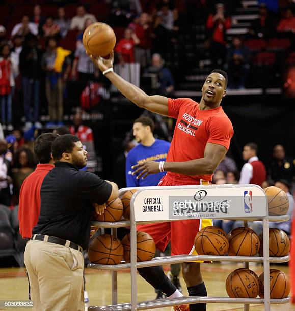 Dwight Howard of the Houston Rockets warms up before playing the Golden State Warriors at Toyota Center on December 31 2015 in Houston Texas NOTE TO...