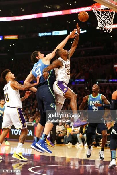 Dwight Howard of the Los Angeles Lakers and Boban Marjanovic of the Dallas Mavericks reach for a rebound during the first half at Staples Center on...