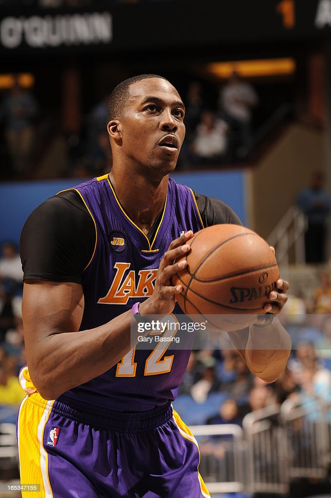 Dwight Howard #12 of the Los Angeles Lakers attempts a foul shot against the Orlando Magic on March 12, 2013 at Amway Center in Orlando, Florida.