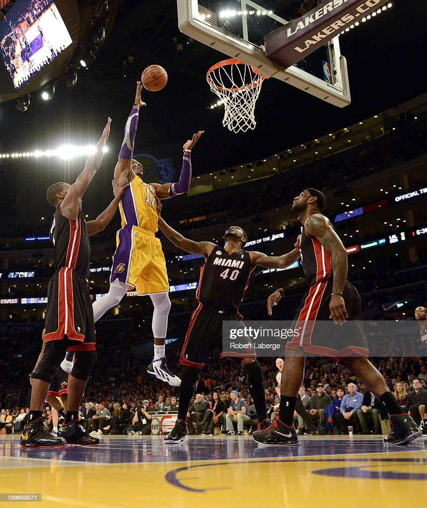 Dwight Howard #12 of the Los Angeles Lakers attempts a shot against Chris Bosh #1, Udonis Haslem #40 and Lebron James #9 of the Miami Heat at Staples Center on January 17, 2013 in Los Angeles, California.