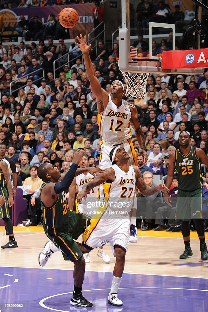 Dwight Howard #12 of the Los Angeles Lakers blocks a shot by Paul Millsap #24 of the Utah Jazz at Staples Center on December 9, 2012 in Los Angeles, California.