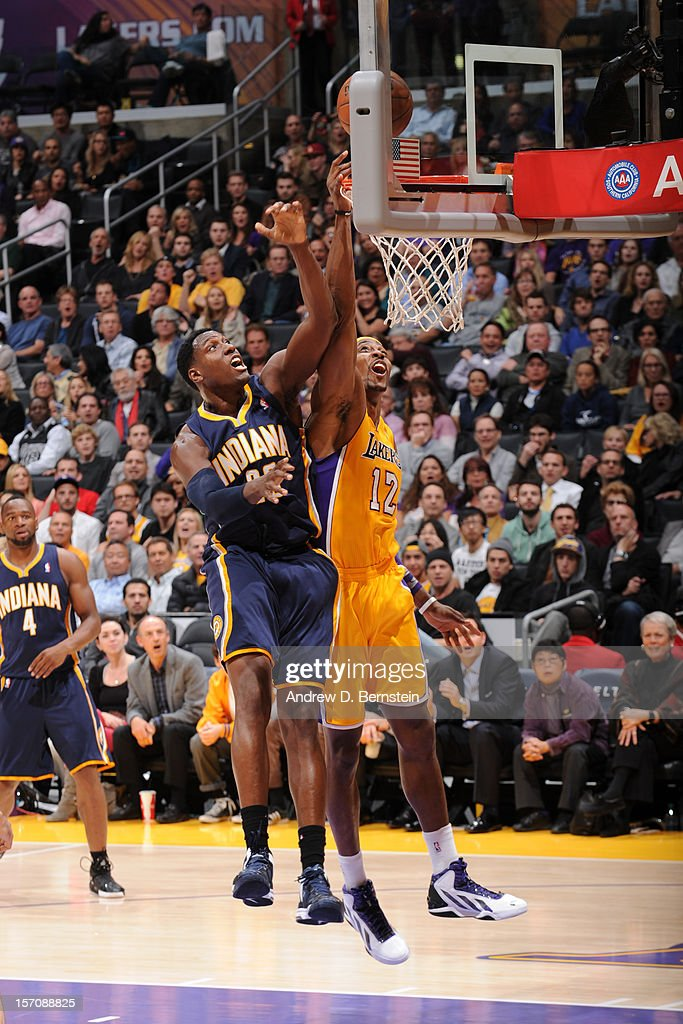 Dwight Howard #12 of the Los Angeles Lakers drives to the basket against Ian Mahinmi #28 of the Indiana Pacers at Staples Center on November 27, 2012 in Los Angeles, California.