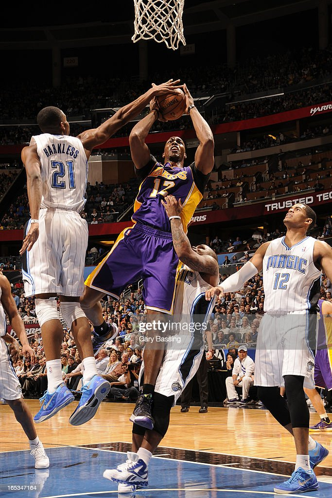 Dwight Howard #12 of the Los Angeles Lakers drives to the basket against the Orlando Magic on March 12, 2013 at Amway Center in Orlando, Florida.