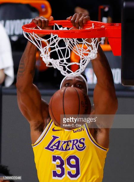 Dwight Howard of the Los Angeles Lakers dunks against the Portland Trail Blazers during the fourth quarter in Game Five of the Western Conference...