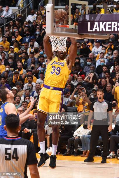 Dwight Howard of the Los Angeles Lakers dunks the ball against the Golden State Warriors on October 19, 2021 at STAPLES Center in Los Angeles,...