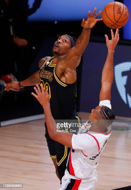 Dwight Howard of the Los Angeles Lakers fouls CJ McCollum of the Portland Trail Blazers during the second quarter in Game Four of the Western...