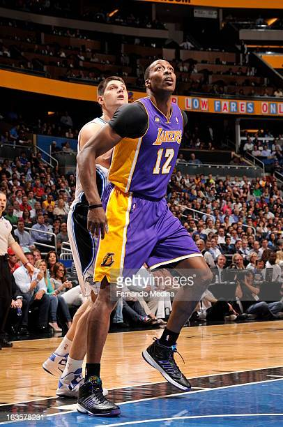Dwight Howard of the Los Angeles Lakers gets ready to grab a rebound against the Orlando Magic during the game on March 12 2013 at Amway Center in...