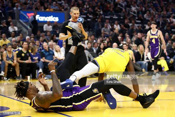 Dwight Howard of the Los Angeles Lakers gets tangled up with Draymond Green of the Golden State Warriors at Chase Center on February 27 2020 in San...