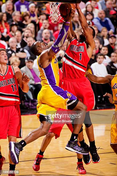 Dwight Howard of the Los Angeles Lakers goes to the basket against Jared Jeffries of the Portland Trail Blazers during a game on October 31 2012 at...