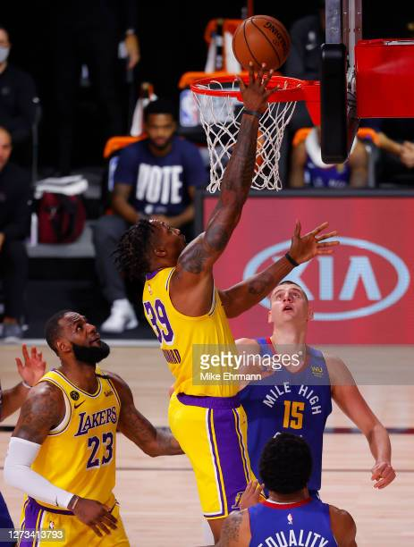 Dwight Howard of the Los Angeles Lakers goes up for a shot against the Denver Nuggets during the third quarter in Game One of the Western Conference...