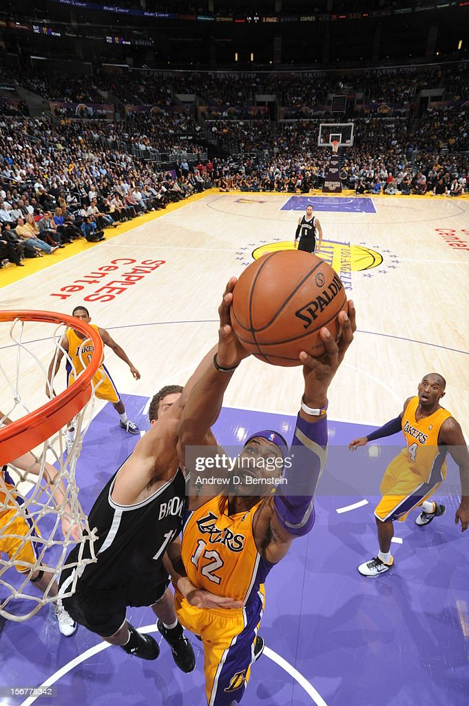 Dwight Howard #12 of the Los Angeles Lakers goes up for a shot against Brook Lopez #11 of the Brooklyn Nets at Staples Center on November 20, 2012 in Los Angeles, California.